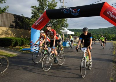 foodbankst-events-tour-de-keuka-cyclists-crossing-the-finish-line