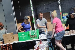 foodbankst giving out food 300x200 - foodbankst-giving-out-food
