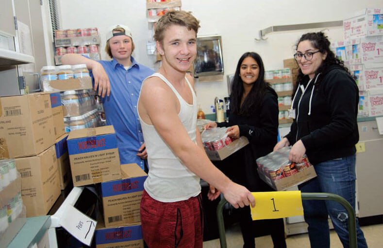foodbankst group of teen volunteers - Piloting A Pantry, Creating Community