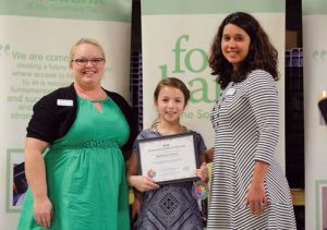foodbankst president giving studen an award 300x211 - foodbankst-president-giving-studen-an-award