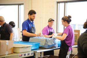 foodbankst sorting food 300x200 - foodbankst-sorting-food