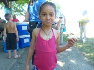 foodbankst summer food service program little girl eating a wrap 300x225 - foodbankst-summer-food-service-program-little-girl-eating-a-wrap