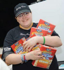 foodbankst teen holding food 274x300 - foodbankst-teen-holding-food