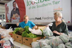 foodbankst volunteers bagging lettuce 300x200 - foodbankst-volunteers-bagging-lettuce