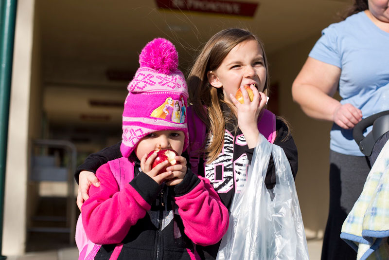 foodbankst ways to give legacy girls eating apples - Leave A Legacy