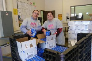 volunteers packing food into boxes 300x200 - volunteers-packing-food-into-boxes